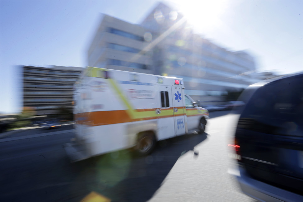 An ambulance drives near  University Hospital of Newark in Newark, New Jersey. (AP Photo)