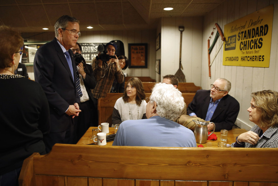 Republican presidential candidate Jeb Bush, left, speaks with potential voters at a restaurant in Urbandale, Iowa, Jan. 13, 2016. (AP Photo