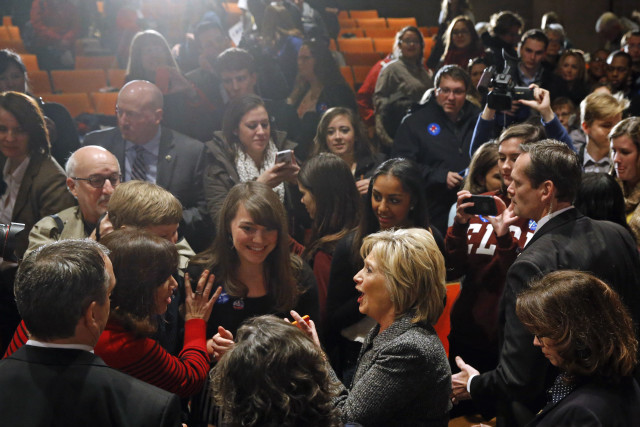 Democratic presidential candidate Hillary Clinton, bottom right, greets attendees after speaking at Iowa State University in Ames, Iowa, Jan. 12, 2016. (AP Photo)