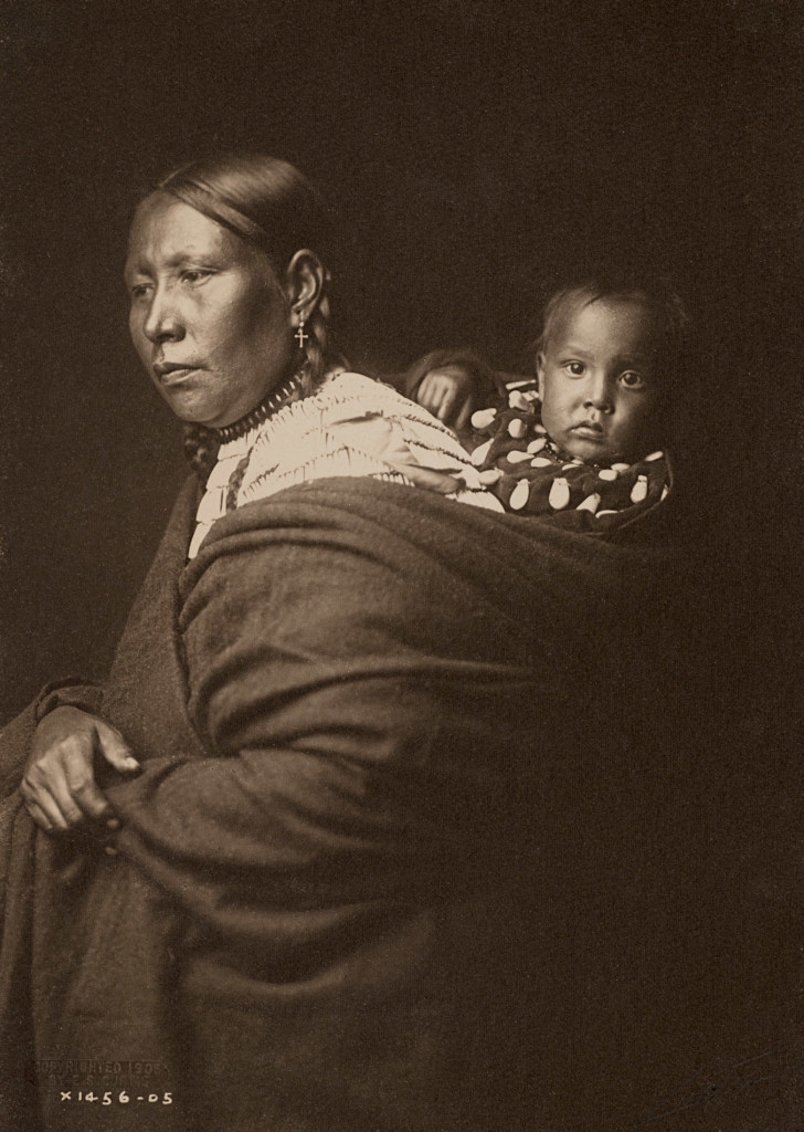 Sioux Mother and Child, 1905, Great Plains (Photo by Edward S. Curtis, courtesy DelMonico Books • Prestel)