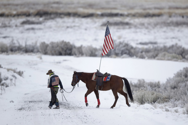 Cowboy Dwane Ehmer, of Irrigon, Oregon, a supporter of a small, armed group that occupied a remote refuge in Oregon to protest federal land policies, walks his horse near Burns, Oregon, on Jan. 7, 2016. (AP Photo)