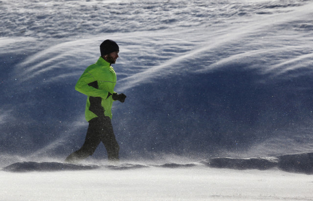 A jogger goes for a run in Maine, where 1.2 million of the state's 1.3 million residents are white. (AP Photo)