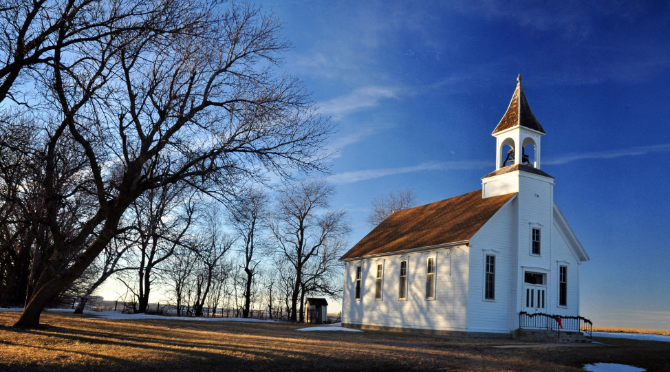 A country church in rural Iowa. (Photo by Flickr user TumblingRun via Creative Commons license)