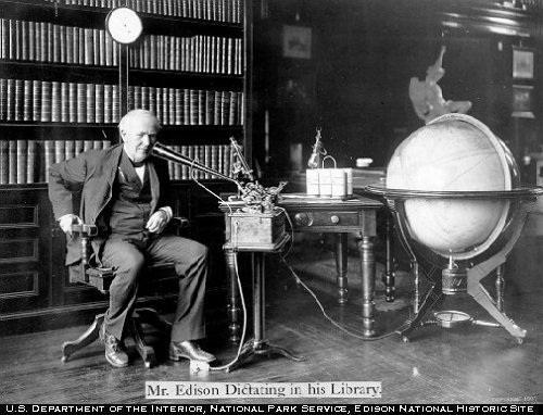 U.S. inventor Thomas Edison speaks into an Edison Dictating Machine, circa 1907. (US Department of the Interior)