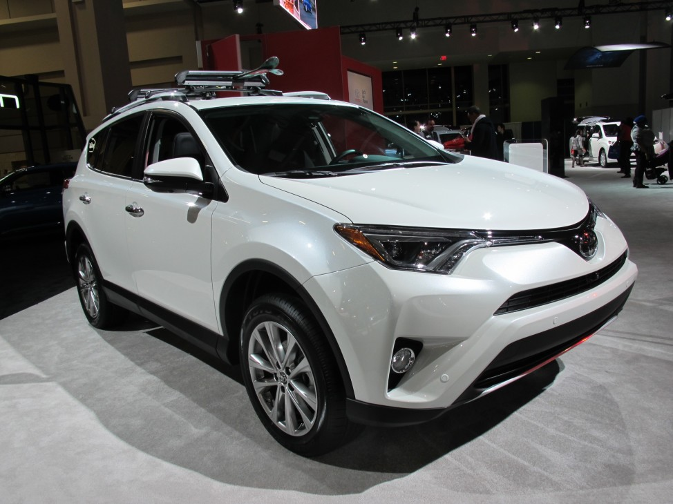 A white Toyota RAV4 gleams at the Washington Car Show on Jan. 28, 2016. White is the most popular auto color in the United States and abroad. (C. Guensburg/VOA)