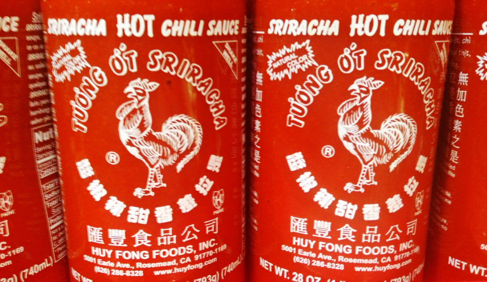 Sriracha is a hot sauce or chili sauce made from chili peppers, distilled vinegar, garlic, sugar and salt. (Photo by Flickr user Mike Mozart via Creative Commons license)