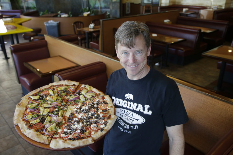 Chuck Hammers, owner of Pizza My Heart, in one of his shops in San Jose, California on March 28, 2016. (AP Photo)