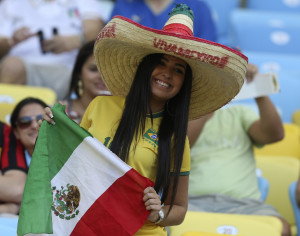 A fan of Mexico smiles before the Confederations Cup Group A soccer match between Mexico and Italy at the Estadio Maracana in Rio de Janeiro