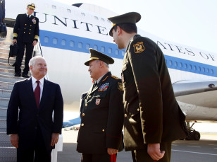 U.S. Defense Secretary Robert Gates meets Azerbaijan's Defence Minister Abiyev  upon his arrival at the Heydar Aliyev International Airport in Baku