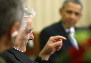 Uruguay's Mujica delivers remarks as Obama welcomes him before their meeting in the Oval Office in Washington