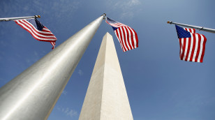Flags flutter during re-opening ceremony for Washington Monument in Washington
