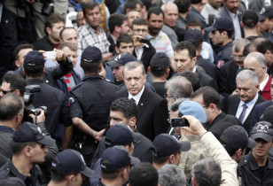Turkey's Prime Minister Erdogan walks during his visit to Soma, a district in Turkey's western province of Manisa, after a coal mine explosion