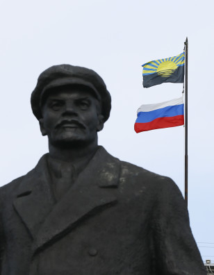 View shows statue of Soviet state founder Lenin in front of the mayor's office, with flags of Russia and Donetsk region erected on the roof, in Slaviansk