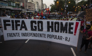 Protesters demonstrate against the public spending for the 2014 World Cup in Rio de Janeiro