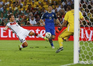 Germany's Goetze shoots to score a goal past Argentina's goalkeeper Romero during extra time in their 2014 World Cup final at the Maracana stadium in Rio de Janeiro