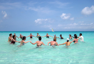 Tourists exercise in the water at the Santa Maria Key Resort in central Cuba