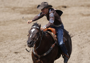 Melby of Burneyville, Oklahoma rides her horse in the barrel racing event during the 101st Calgary Stampede rodeo in Calgary