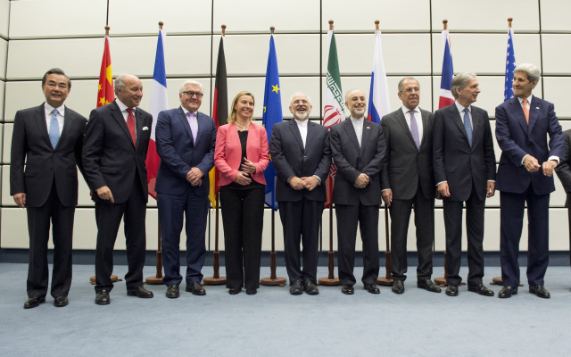 Ministers and officials pose for a group picture at the United Nations building in Vienna