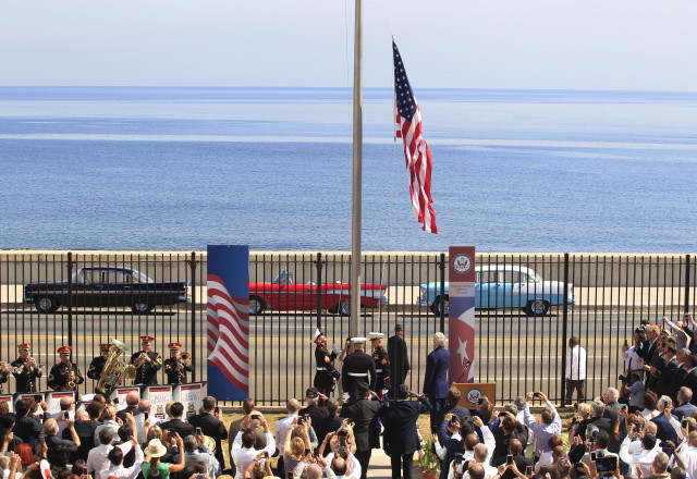 U.S. marines raise the U.S. flag while watched over by U.S. Secretary of State John Kerry at the U.S. embassy in Havana