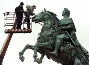 Workers clean a monument to Peter the Great, the founder of St. Petersburg May 6. The city is prepar..