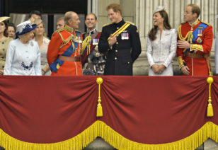 (Front L-R) Britain's Queen Elizabeth, Prince Philip, Prince Harry, Prince William, the Duke of Cambridge and his wife, Catherine, the Duchess of Cambridge share a light moment as they stand on the balcony of Buckingham Palace in the annual Trooping of the Colour ceremony to celebrate the Queen's official birthday in central London, June 14, 2014. REUTERS/Toby Melville (BRITAIN - Tags: SOCIETY ANNIVERSARY ROYALS) - RTR3TQWU