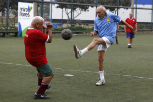 Senior soccer players take part in a match at a soccer field in Miraflores