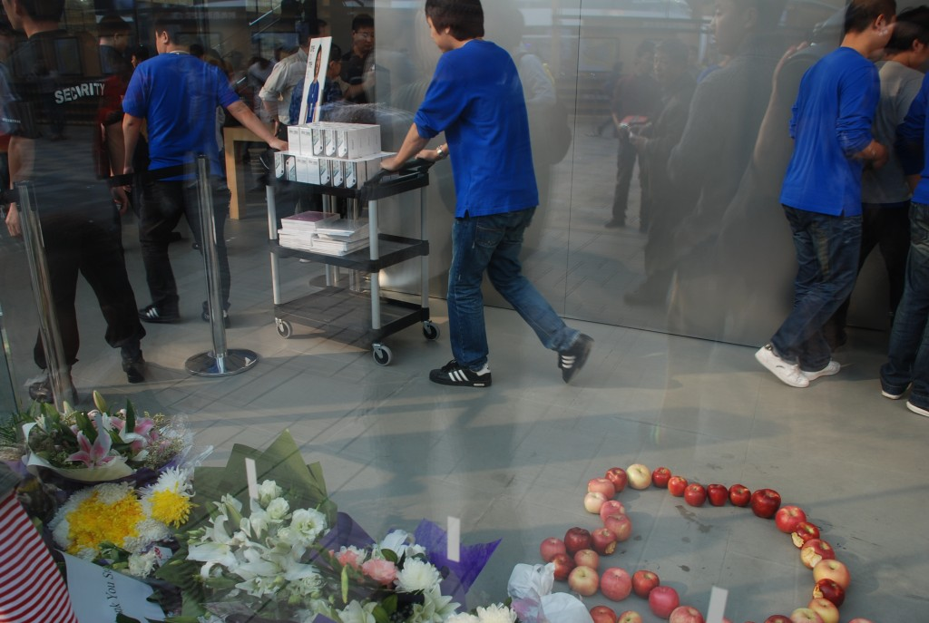 Workers at the Apple store in Beijing wheel out new iPhone 4s