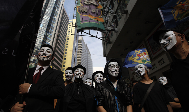 Protesters wearing masks take to the streets to appeal for people to join them for an upcoming protest in Hong Kong