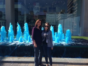 My mom and I pose in front of one of the many blue fountains.