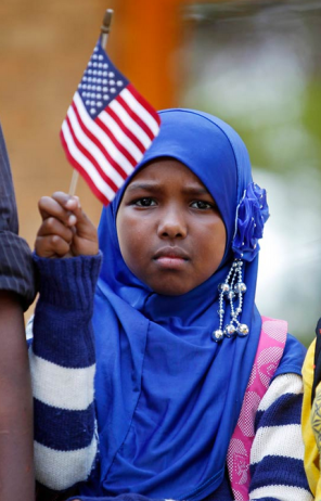 Minnesota's ethnic Somali population has mushroomed in the last two decades from a small group to more than 50,000. On September 27, 2013, hundreds, including Ilhan Issa, gathered at a solidarity rally in Minneapolis to protest terrorist attacks by Al-Shabab. (AP)