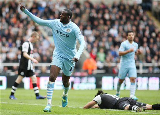 Yaya Toure na Manchester City yana murnar daya daga cikin kwallaye biyu da ya jefa a ragar 'yan wasan Newcastle United a wasan da suka buga ranar lahadi, 6 Mayu, 2012 a filin wasa na Sports Direct Arena, Newcastle, wanda ya gusar da City ga lashe kofin lig-lig na EPL na 2012.
