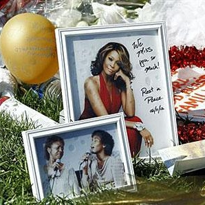A makeshift memorial to Whitney Houston is seen in front of The Beverly Hilton hotel in Beverly Hills, California, (AP February 17, 2012)