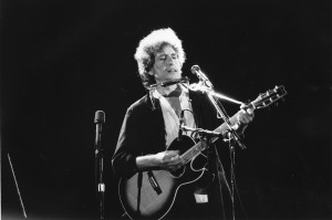 Bob Dylan & his acoustic guitar--date unknown. The 72-year old was awarded France's highest cultural honor November 13th in Paris. (AP Photo)