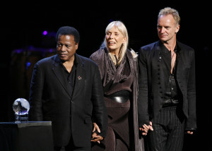 From left, Wayne Shorter, Joni Mitchell and Sting listen to a program on stage during an all-star tribute concert for Herbie Hancock, Sunday, Oct. 28, 2007, in Los Angeles. (AP Photo)