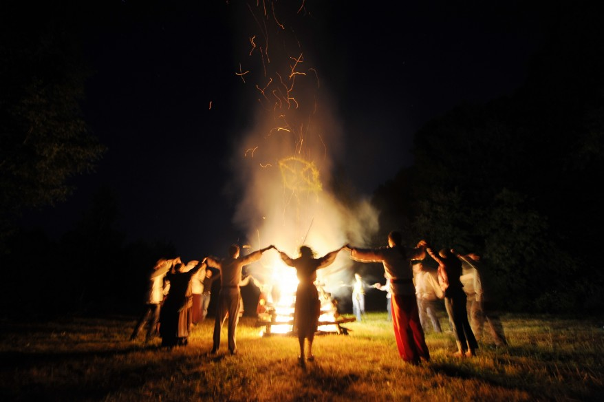 Belarussians in traditional costumes dance around a fire near the village of Raduga in the Gomel region, some 300 kms southeast the capital Minsk, to mark Ivana Kupala night, an ancient heathen holiday. During the celebrations, dating back to pagan times, people wear wreathes, jump over fires and bathe naked in rivers and lakes. (AP)