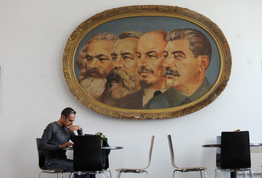 A man works on his laptop in the cafe of the Museum of Socialist Art in Sofia, Bulgaria, after the opening ceremony. Twenty-two years after the fall of its communist regime, Bulgaria opened on Monday its first-ever museum of the state-sponsored, propaganda art characteristic of that era. The Museum exhibited some 77 monumental sculptures, 60 paintings and 25 smaller plastic art works created between 1945 and 1989 by the most renowned sculptors and painters of the time. (AFP)