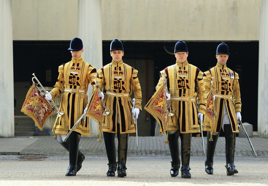 State fanfare trumpeters of the Household Cavalry dressed in their summer uniforms at Wellington Barracks show uniforms that will be worn for the Queen's Diamond Jubilee celebrations, London, March 21, 2012.