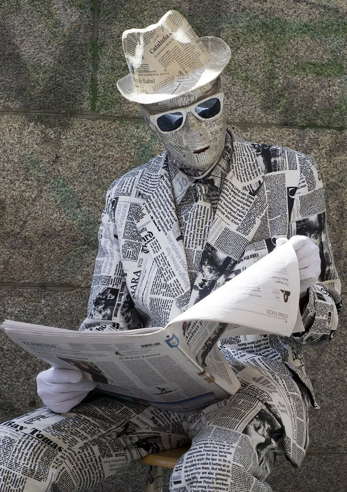Newspaper Living Statue