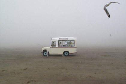 An ice cream van stands on a foggy beach in Whitby, northern England July 7, 2012. (Reuters)