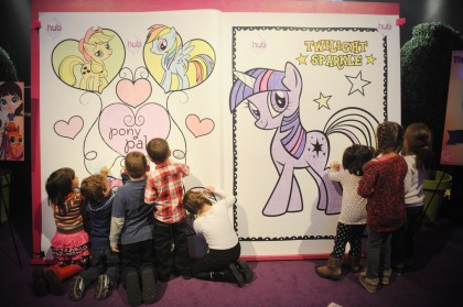 Children color on The My Little Pony Coloring Book at The Hub's Playdate Premiere Party in New York.  The extra large coloring book was measured for the Guinness Book of World Records. (AP)