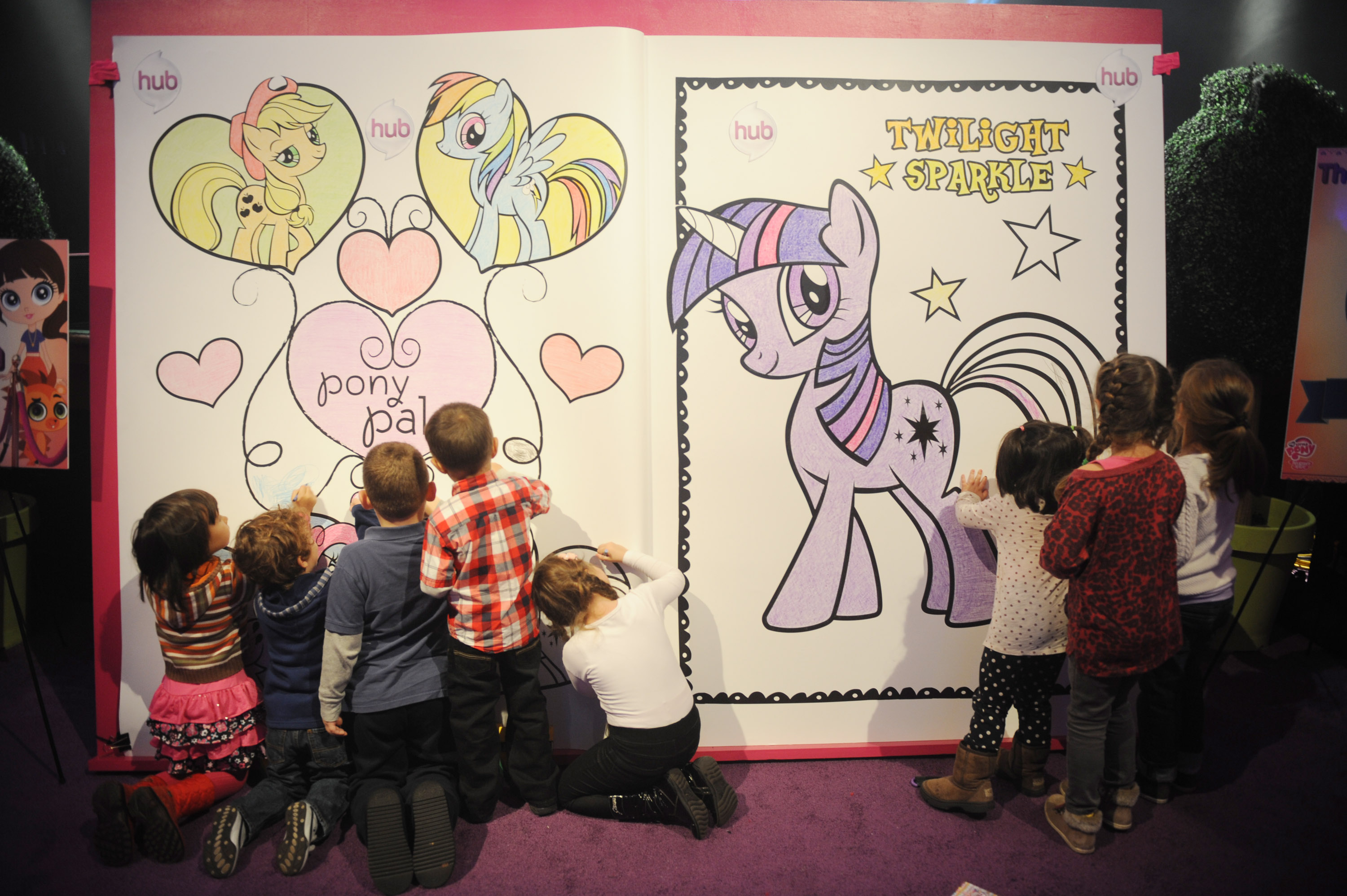 Children Color On The My Little Pony Coloring Book At The