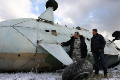 British actor John Rhys-Davies, left, and Hungarian actor Ivan Kamaras have a chat during the shooting of a scene of the film Ice Age 2 at the 86th Szolnok Helicopter Base in Szolnok, 100 km southeast of Budapest, Hungary, November 9, 2012. (AP)