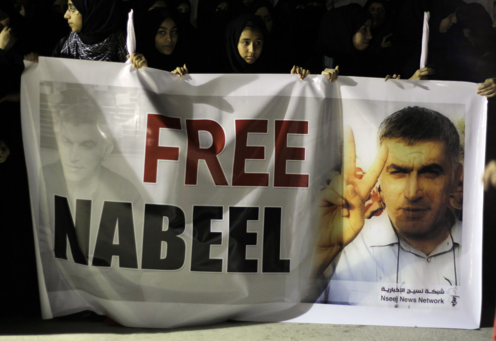 Supporters of jailed Baharini human rights activist Nabeel Rajab hold up a banner demanding his freedom Sunday, May 6, 2012, in the northwestern village of Bani Jamra, Bahrain. AP