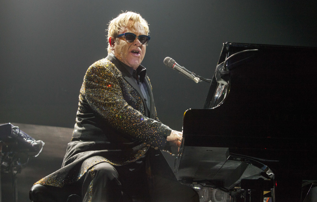 Sir Elton John performs at the Allstate Arena on Saturday, Nov 30, 2013, in Rosemont, IL. (Photo by Barry Brecheisen/Invision for Invision/AP)