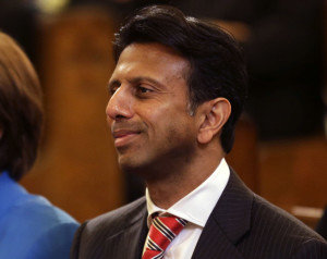 "Louisiana Gov. Bobby Jindal attends a funeral Mass for artist George Rodrigue, at St. Louis Cathedral in New Orleans, Thursday, Dec. 19, 2013. ""Duck Dynasty"" patriarch Phil Robertson - suspended from the series indefinitely after making disparaging remarks about gays - is getting some support from key followers, including Jindal. He lamented the suspension on free speech terms. ""It's a messed-up situation when Miley Cyrus gets a laugh, and Phil Robertson gets suspended,"" he said in a statement Thursday. The show is filmed in his state. (AP Photo/Gerald Herbert)"