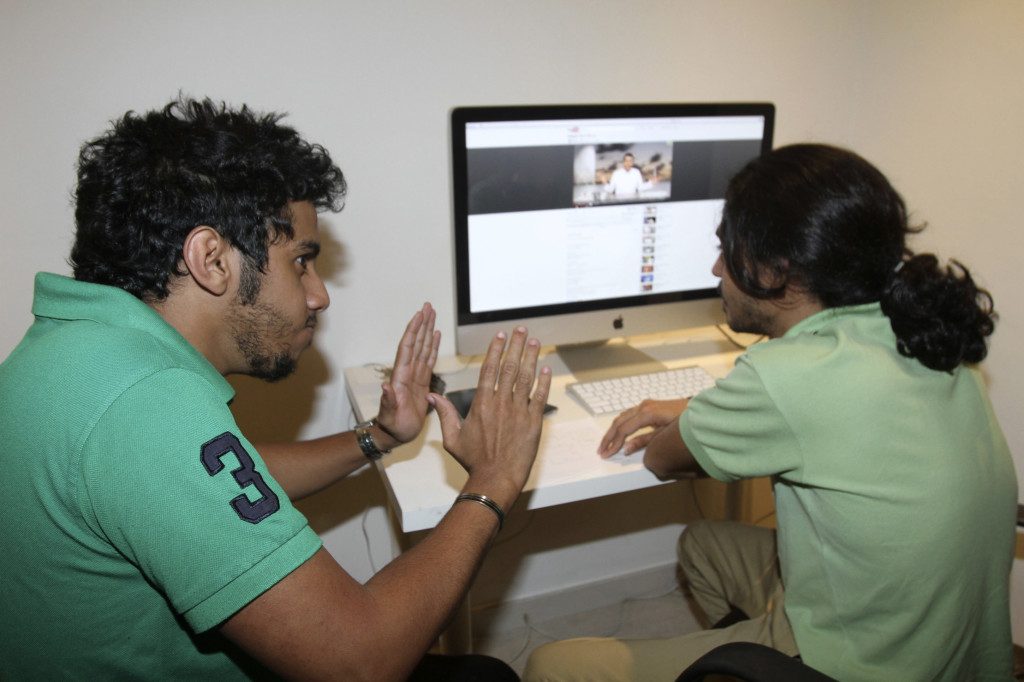 Members of the Uturn comedian group work on a Youtube video in Jeddah March 26, 2012. The media is censored and reporters who cross unofficial red lines can face the sack, hefty fines or even prison sentences. But bloggers and contributors to online forums now openly discuss social ills, government inefficiency and corruption, while a Twitter user who ridicules the royal family has attracted 250,000 followers. Picture taken March 26, 2012. To match Feature SAUDI-ONLINE/TABOO REUTERS/Susan Baaghil