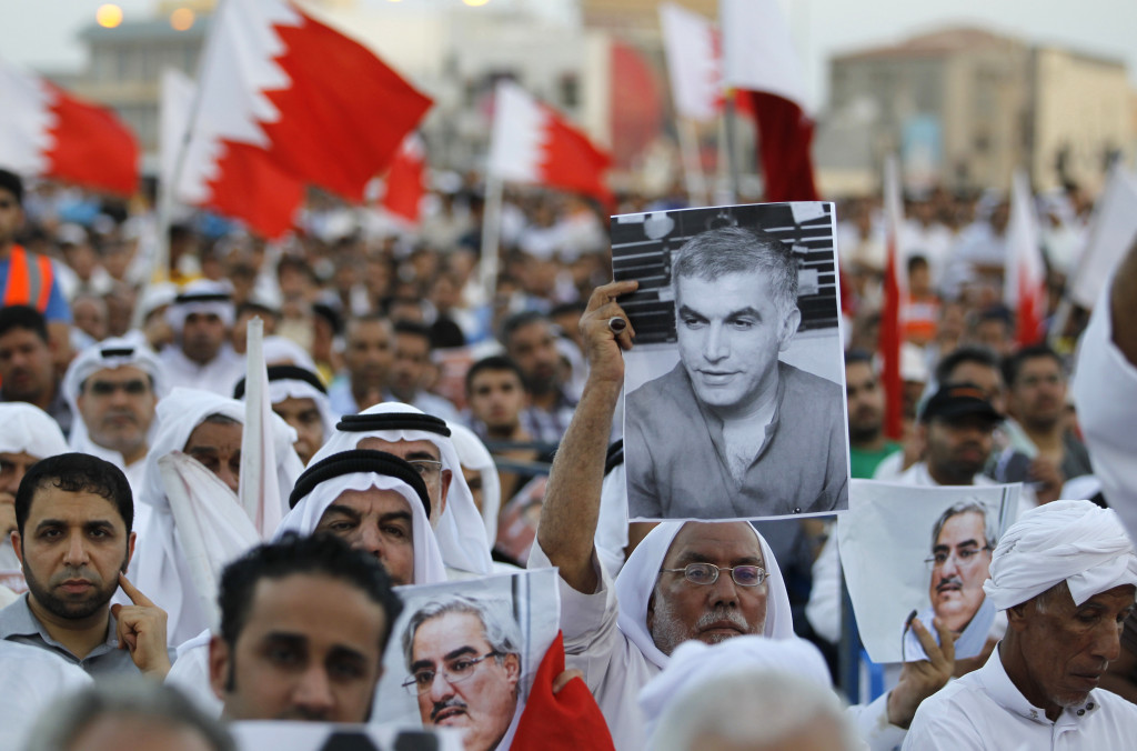 An anti-government protester holds a picture of Nabeel Rajab, founder of the Bahrain Centre for Human Rights, during a sit-in organized by Bahrain's main opposition party Al Wefaq, at the village of Muqsha, west of Manama, September 20, 2013. REUTERS/Hamad I Mohammed