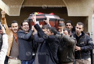 Mourners carry the coffin of Yasser Faysal al-Joumaili during his funeral procession in Falluja, 50 km (31 miles) west of Baghdad, December 8, 2013. An al Qaeda-linked group in Syria executed Joumaili, an Iraqi freelance cameraman and the first foreign journalist killed by insurgents in the conflict, a press freedoms watchdog said on December 5, 2013. The Paris-based Reporters Without Borders said the al Qaeda-affiliated Islamic State of Iraq and the Levant (ISIL) seized Joumali while he was on a reporting trip in northern Syria's Idlib province on December 4, 2013. Joumali was then executed and his body later arrived in Turkey, although the exact circumstances of his death were unclear, the report said. Joumali, 32, was from the Iraqi city of Fallujah and had three children, it added. He worked for Reuters in Iraq from 2003 to 2009. Reporters Without Borders said Joumali was the 20th professional journalist and 8th foreign journalist to die in the Syrian conflict, which started in May, 2011 as a peaceful protest movement and slid into civil war after a crackdown. REUTERS/Thaier Al-Sudani