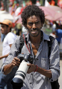 Al Jazeera journalists are not the only ones arrested in Egypt. This undated photograph shows Mohammed Abdel-Moneim, a photojournalist with Al-Badil newspaper, who was arrested with another photographer, Ahmed Hendawi from Yqeen online news network by Egyptian security forces while covering a demonstration in Cairo, Egypt, Friday, Dec. 6, 2013. Military prosecutors interrogated the two journalists arrested a day earlier during a protest organized by supporters of ousted President Mohammed Morsi in an eastern Cairo neighborhood, Rawda Ahmed, a lawyer at the Arab Network for Human rights Information, said Saturday.(AP Photo/Mohammed el-Shahed)