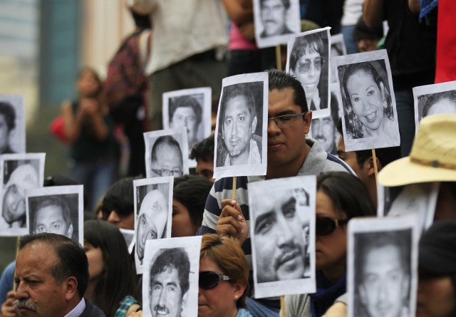 Journalists hold photographs of colleagues who have been killed in the last years while covering the news in Mexico, in Mexico City February 23, 2014. Journalists took to the streets several weeks after Gregorio Jimenez de la Cruz, a reporter for the Veracruz state newspaper Notisur y Liberal del Sur, was kidnapped and found buried along with two people. The Committee to Protect Journalists called on Mexican authorities to conduct a thorough investigation into the murder of Jimenez de la Cruz according to a press release. Jimenez de la Cruz was the second journalist to be killed in 2014, according to local media. REUTERS/Henry Romero